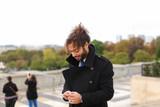 Arabian groom talking on smartphone near Eifel Tower in slow mot - 183056857