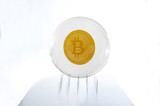 Bitcoin inside a bubble over a needles bed simulating the fragility of this speculative currency - 183064851
