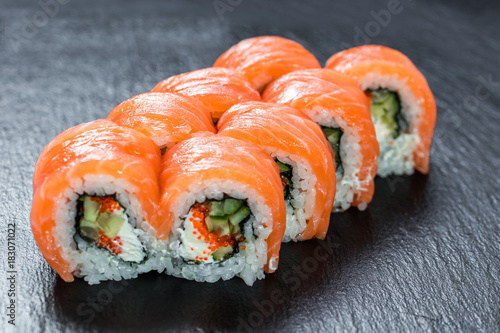 Tuinposter Sushi bar Big portion of philadelphia makizushi roll with salmon