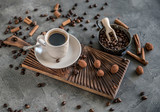 Black coffee with candies on a concrete background - 183079477