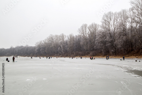winter fishing fishermen fish on the lake
