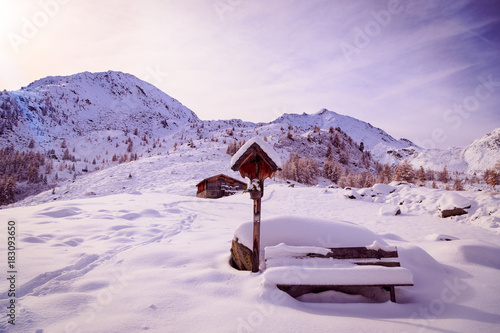 Fotobehang Purper Alpine hut covered by the snow