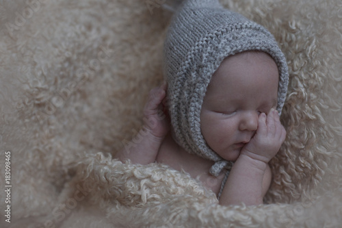 Newborn baby sleeping. Cute baby in hat Poster