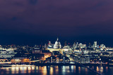 Aerial view of London cityscape skyline at night with St Paul's Cathedral