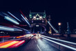 City light trails of London bus traffic on Tower Bridge in London at night
