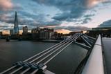 Modern London skyline on River Thames with Millennium Bridge and Shard building - 183100804