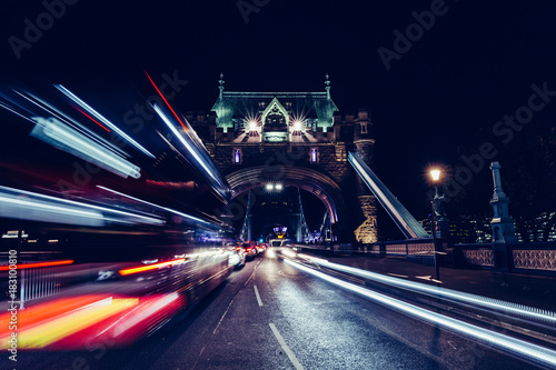 fototapeta na ścianę City light trails of London bus traffic on Tower Bridge in London at night