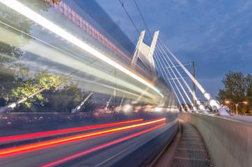 tram traffic on bridge, tramway in the evening, Krakow, Poland,