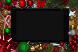 Blank tablet surrounded with Christmas decorations - 183110290