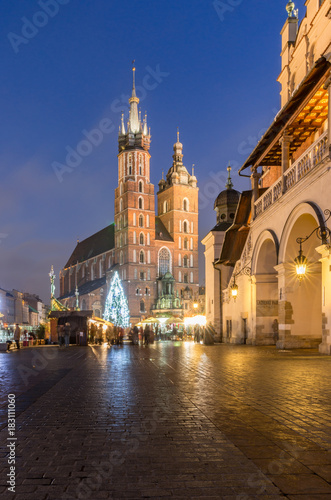 Christmas tree, St Mary's church, Cloth Hall on Main Market Square in Krakow, illuminated in the night © tomeyk