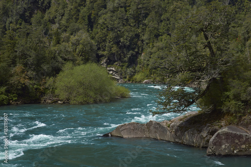 Fotobehang Rio de Janeiro River Futaleufu flowing through a forested valley in the Aysén Region of southern Chile. The river is renowned as one of the premier locations in the world for white water rafting.