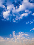 Fluffy clouds in the blue sky with morning light from the sunrise - 183143664