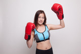 Beautiful healthy Asian girl with red boxing glove. - 183145851