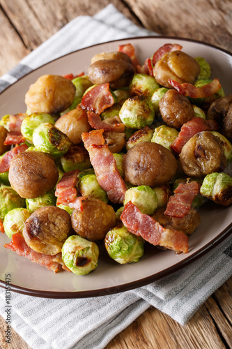 In de dag Brussel Fried chestnuts, brussels sprouts and bacon closeup. vertical