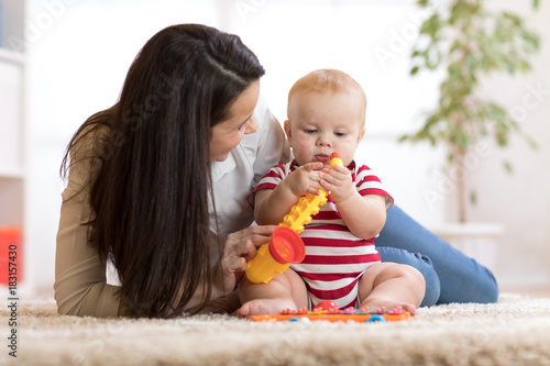Happy mother playing with baby at home © Oksana Kuzmina