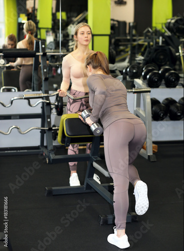 Póster Workout in the gym .Two girls