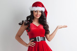 Christmas girl holding something - 183181873