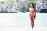 Woman walking on beach - 183182411