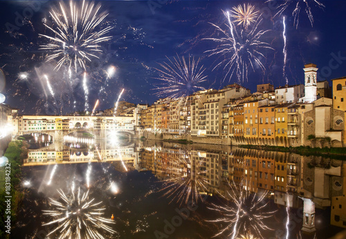Tuinposter Florence celebrating New year's eve in Florence, Italy - explosive fireworks around ponte vecchio on river arno