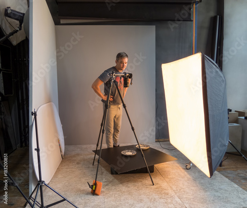 photographer photographing objects in the studio. unintended photography