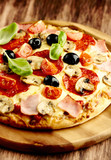 Pizza with ham, salami, cherry tomatoes and mushrooms - 183202640