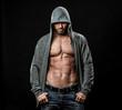 Muscular man in gray hoodie