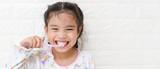Little asian cute girl brush teeth - 183206612