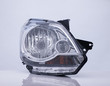 closeup of a car headlight on white background with reflection. isolated