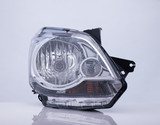 closeup of a car headlight on white background with reflection. isolated - 183206819