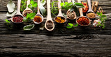 Herbs and spices on wooden background - 183208280