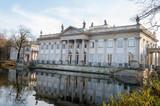 Historic palace by the lake during sunny fall day, Lazienki Krolewskie Warszawa Poland - 183209664