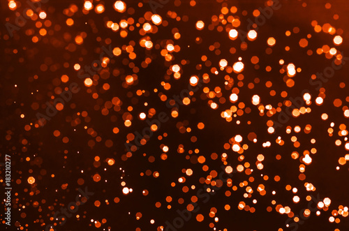 abstract red bokeh shining for christmas and happy new years celebration background.