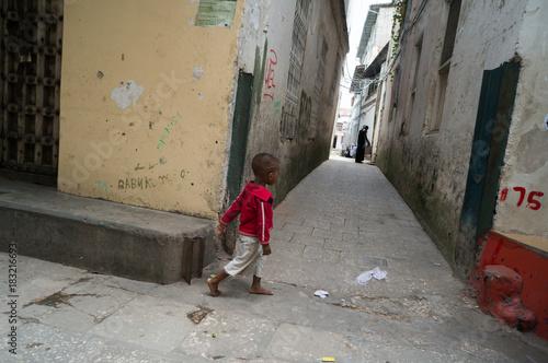 Tuinposter Zanzibar Little boy in Stone Town Zanzibar