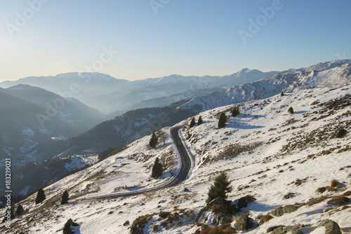 Foto op Plexiglas Grijs mountains covered with snow on a sunny day