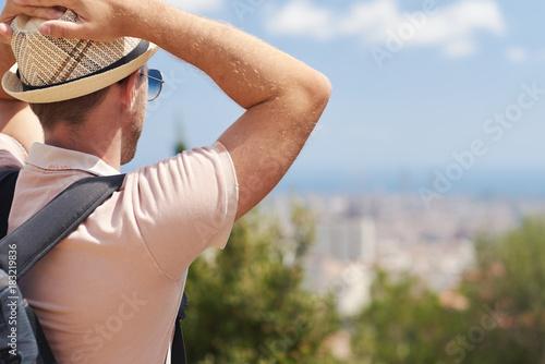 Sticker Traveler in sunhat is enjoying a beautiful view.