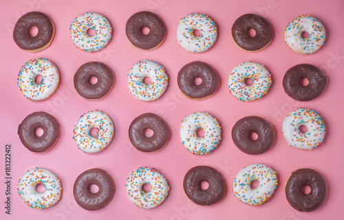 many donuts on pink background, pattern