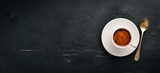A cup of espresso coffee on a dark wooden background. Top view. Free space for text. - 183224881
