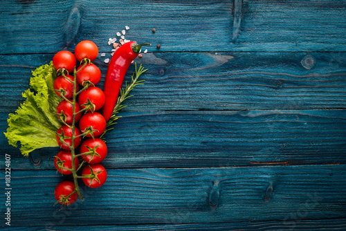 Plexiglas Kersen Preparation for cooking. Cherry tomatoes. Fresh vegetables and spices on a wooden background. Top view