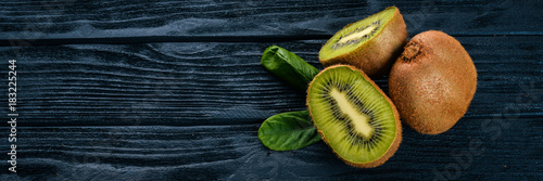Kiwi on a wooden background. Fresh fruits. Top view. Free space for text.