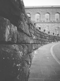 Stone wall on a historical building in Italy. Curving wall to the right. Image in black and white. - 183228605