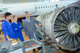 Students looking at aircraft turbine - 183236054