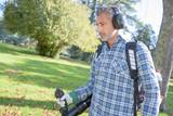 garden worker using a leaf blower - 183241056