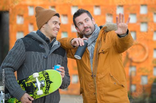 skater and graffiti artist talking Poster