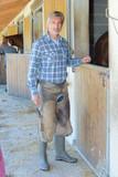 man at stables - 183243497
