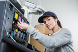 Female technician changing ink cartridges of a photocopier - 183246484