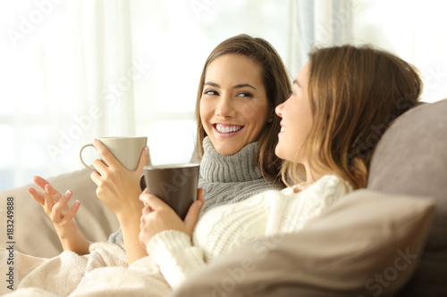 Two roommates talking on couch in winter
