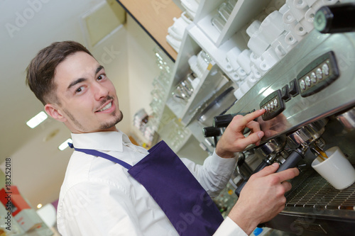 Papiers peints Cafe Portrait of waiter using coffee machine