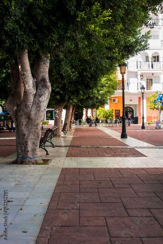 Fototapeta Street. Traditional Spanish Street. Estepona, Costa del Sol, Andalusia, Spain. Picture taken – 1 december 2017.
