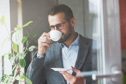 Sticker handsome businessman holding morning cup of coffee