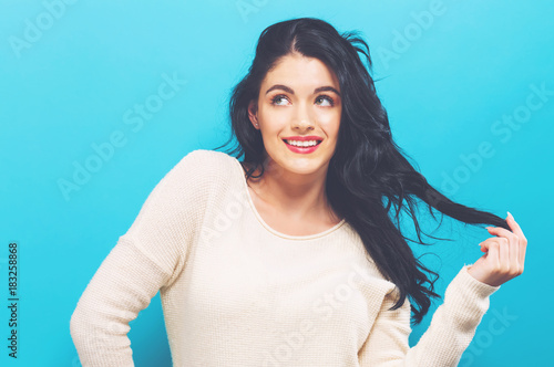 Plakát Happy young woman on a solid color background